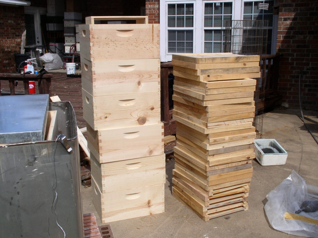 Boxes and bottom boards ready to undergo treatment.